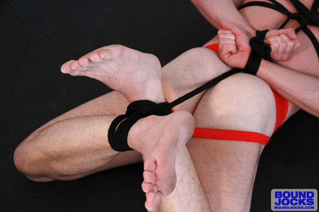 Bound-Jocks-jock-Mitch-Branson-shaved-hogtied-gagged-boxing-jockstrap-strokes-hard-cock-gushes-cum-load-003-male-tube-red-tube-gallery-photo