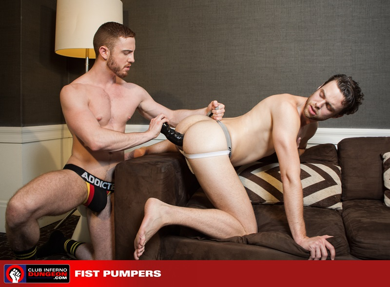 JP Dubois keeps his fist deep in Brandon Moore as his jerks his fat uncut cock