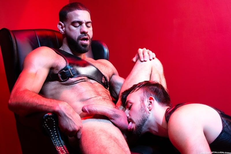 Hairy muscle dude Ricky Larkin drops to his knees to suck down hard on Mason Lear's rock-hard cock